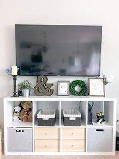 Our Neutral Modern Farmhouse Living Room - TryEverythingBlog.com - IKEA Kallax media console | shelf decoration | square cubby organization