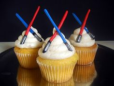 Some Star Wars cupcakes! Vanilla cake. Lightsabers made with fondant and painted with lusterdust and food coloring.