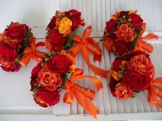 Orange and Red Autumn and Fall Rich and Romantic Bridal Bridesmaids Boutonniere Destination Wedding Bouquet Set. $599.00, via Etsy.
