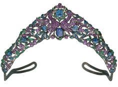"""BIRDS OF PARADISE TIARA"" An Antique Ruby, Sapphire, and Emerald Tiara c1850s. The tapered openwork band centering upon two birds of paradise set with rubies, in a sapphire, ruby and emerald foliage surround, enhanced by larger cushion-shaped sapphire collets, mounted in silver. Probably Russian. From the Collection of Mrs. Lily Safra sale at Christie's."
