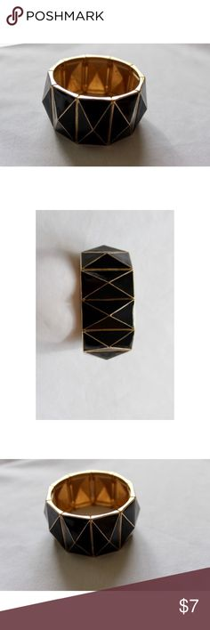 🆕Charming Charlie Black Pyramid Stretch Bracelet This beautiful bracelet is a statement piece! It was purchased from charming Charlie and has only been worn twice since then. The Pyramids are black enamel and the metal is gold. It is a structured Stretch Bracelet which gives the illusion that it is a bangle when on. This piece is in excellent condition! Bundle this bracelet with other items in my closet to save 15% on your order! Charming Charlie Jewelry Bracelets