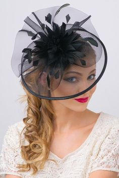 You are a picture of glamorous sophistication when you put on this romantic fascinator! Modern with a vintage touch, this elegant horse hair mesh base adorns a beautiful bouquet of soft feathers. A soft satin trim offers and allure thats simply breathtaki Black Fascinator, Fascinator Headband, Fascinators, Turban, Feather Bouquet, Types Of Hats, Kentucky Derby Hats, Fancy Hats, Wedding Hats
