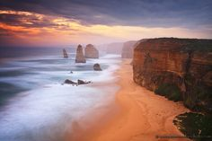 Great Ocean Road (Australia). 'The Twelve Apostles − rock formations jutting out of wild waters − are one of Victoria's most vivid sights, but it's the 'getting there' road trip that doubles their impact. Take it slow while driving along roads that curl beside spectacular Bass Strait beaches, then whip slightly inland through rainforests alive with small towns and big trees.' http://www.lonelyplanet.com/australia/victoria/great-ocean-road