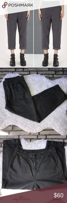 """Topshop Gray Boyfriend Wide Leg Jean By Boutique 6 A gray wash adds to the off-duty vibe of high-rise jeans cut in a relaxed, ankle-length silhouette. 24"""" inseam; 14"""" leg opening; 12"""" front rise; waist (flat) 15"""". Zip fly with button closure. Five-pocket style. 100% cotton. Machine wash warm, line dry. By Topshop Boutique; imported. Garment is labeled: EUR 38, US 6, UK 10. Fits like a US 2-4. Topshop Jeans Boyfriend"""