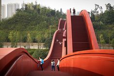 NEXT architects has completed the lucky knot, a bridge in the chinese city of changsha that offers multiple paths across the dragon king harbour river.