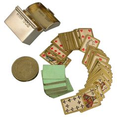 """""""An absolutely minute Victorian silver twin pack Playing Cards Box of rectangular form with hinged lid and silver gilt interior, complete with the original two complete packs of miniature cards by C L Wust of Frankfurt. """""""