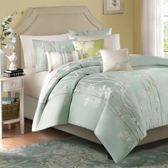 Athena 6-Piece Duvet Set  Light and airy colors of sea mist and celadon bring a bright, refreshing feel to your bedroom. Flowers, stripes and a delicate silhouette of a bird all combine to create a stunning scene on this jacquard duvet set. Ivory and taupe accents complete the palette