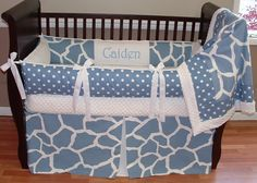 Caiden Giraffe Baby Bedding  This custom crib bedding set includes the bumper, blanket and tailored crib skirt. The blue and white giraffe print coordinate perfectly with the polka dots. The blanket is white minky backed with a soft cuddle edge and the front features both the fabrics.