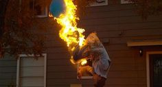 Steve-O Pops A Water Balloon With A Fire-Breathing Backflip