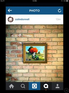 Actor Colin Donnell showing off his newly acquired art.