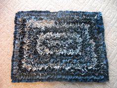 "Denim Rag Rug - made from lots and lots of 2"" X 3"" pieces cut from old jeans - I used the linked tutorial as a pattern"