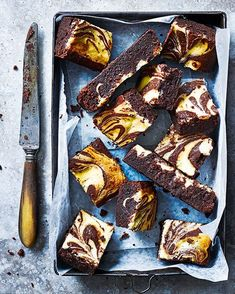 Eric Lanlard swirls a rich cheesecake-like filling though a decadent and fudgey chocolate brownie for an afternoon treat you won't be able to resist.