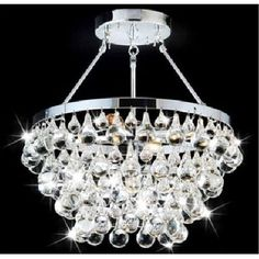 This beautiful chandelier from Warehouse of Tiffany features a chrome base with beautiful dangling glass accents. This 5-light grand chandelier will add style, class and much-needed illumination to any room in your home.