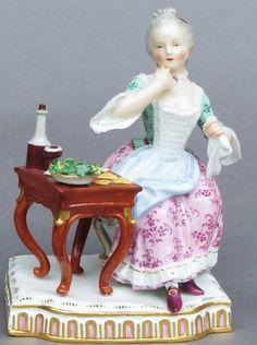 Meissen Model: E 2        Description: The Senses - Taste   Modeled By: Johann Carl Schoenheit ca. 1772   Mark: E 2       Painter Number:    Height: 5.1 in - 13 cm