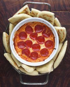 4-Layer Pizza Dip--literally 4 ingredients: ricotta cheese, italian cheese blend, pizza sauce & pepperoni. Yum!