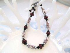 Beaded Bracelet, glass lampwork brick red beads, swarovski crystals, beaded beads in peyote stitch