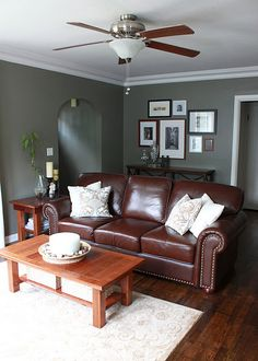 paint color - Benjamin Moore - antique pewter. Love the leather sofa and the rug as well.