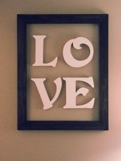 "Wood letters from joann's ($10 for 4 letters) painted white.  Wood frame only from hobby lobby (18""×24""about $12 with 40% off coupon) and then I just hung every thing on the wall.  Is for Valentine's decor but could leave up year round"