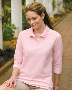 Tri-Mountain Women's Pique Sleeve Golf Shirt. 601, Form meets function in the Aurora shirt for women.The 3/4-sleeve pique knit golf shirt is made from 7.4 oz. 60% cotton/40% polyester. Features a narrow three-button placket and square hemmed bottom. Pearl buttons and double-stitched seams at sleeves and hem.
