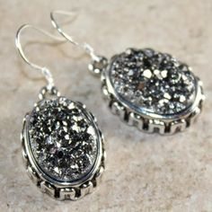 """30% OFF BUNDLES Titanium Druzy Earrings LAST PAIR Titanium Druzy Gray EarringsStone size 13X18 mmEarring length 1 1/2""""I'm offering 30% off bundles. Also, you can use the red dot 4/$20 items to make my discount of 30% kick in Matching bracelet, earrings & ring sold separatelyONE LEFTItem is new, direct from maker without store tags Posh Garden Jewelry Earrings"""