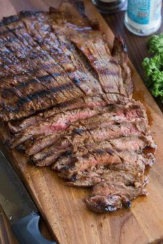 It only takes 5 simple ingredients to make the BEST and easiest marinated flank steak recipe. This has been a family favorite for years!
