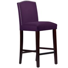 This elegantly arched bar stool features a meticulous individual nail button detail. Upholstered in luxurious velvet fabric and delicately handcrafted in plush foam padding, this beautiful stool looks great in your kitchen, dining room, or bar.