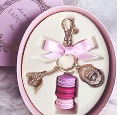 Laduree bag charm. Waiting for mine to arrive, bought in Paris. Totally in  with this.