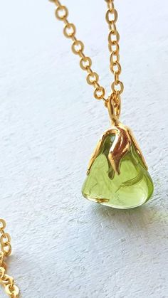 So petite and delicate peridot pendant, so cute!)) Fine clear, green sparkle flashy and very nice colour of gemstone made your day))  The measure of pendant is 10 mm*9 mm approx. The lenght of sterling silver is 450 mm, but if you want another -just tell me please!) Its really cool unisex present too, of course)   You can see more beautiful gemstones jewelry here http://etsy.me/2s0Q6Vp