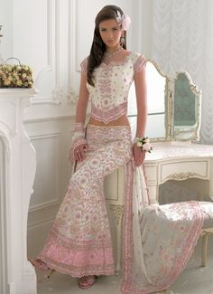 This is such a beautiful and feminine outfit.  The open midriff is probably not something that would work with my body, but I just love the pretty pink, lace trim, and floral pattern.  The complete look would make me feel like such a princess, including the heels and flowers in the hair, natural make-up, and corsage.  The flowing skirt would make me want to just spin around and watch pink and floral designs flowing. The hair so dark, smooth and silky.