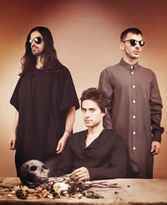 tomo is jesus with sunglasses xD