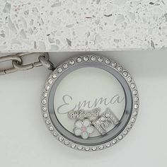 This listing is for a Thank you for being my bridesmaid personalised floating locket wedding keyring. A perfect gift to present to your Bridesmaid to say thank you for being part of your big day The stainless steel locket includes a personalised insert with your bridesmaids name on the front, and on the back it says Thank you for being our bridesmaid with space for both of your names and also the date of your special day. The insert is cream/ivory but I can do other colours. You will...