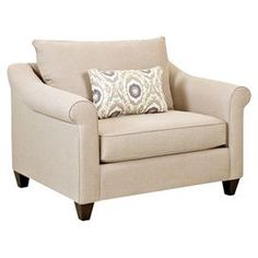 """Featuring welted trim and beige upholstery, this handsome roll-arm chair offers timeless style for your living room or den seating group.  Product: ChairConstruction Material: Polyester, foam and woodColor: Beige and creamFeatures:  One accent pillow includedRolled armsTapered feet Made in the USA 20"""" Seat height23"""" Seat depth  Dimensions: 33"""" H x 52"""" W x 40"""" D"""