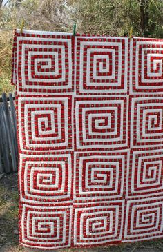 African Quilt Kuba Red Spiral no. 3 by LazyLionQuilts - love the simplicity and graphic quality