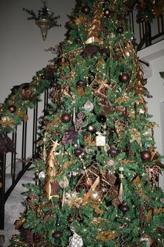Vintage gold and chocolate tree in entrance,matching wreath and banister Xmas 2013