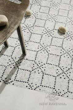 Augustine, a hand-cut stone mosaic, shown in hand-chopped tumbled Calacatta Tia and Nero Marquina, was designed by Paul Schatz as part of the Legend Collection by New Ravenna. Stone Mosaic, Stone Tiles, Mosaic Art, Mosaic Tiles, Mosaics, Tile Accent Wall, Wall Tile, New Ravenna, Tile Wallpaper