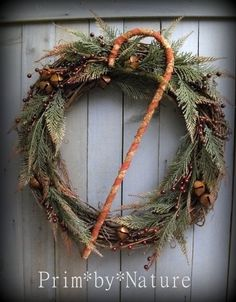 Primitive Christmas Wreath with Shabby Candy Cane Red Berries and Rusty Bells #NaivePrimitive #PrimbyNature