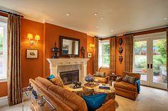 "Family room in a San Francisco Edwardian townhouse designed by Adeeni Design Group: walls Dunn Edwards ""Desert Spice"" #DE5202, ceiling Dunn Edwards ""Ivory Oats"" #DE5358"