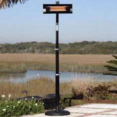 Black Telescoping Offset Mounted Infrared Patio Heater offers a new revolution in outdoor heating! Operating at 90% heating efficiency, this infrared patio heater runs on regular household electric current and is substantially less expensive to operate than propane patio heaters. Relocating this unit is made easy with the convenience of attached wheels.