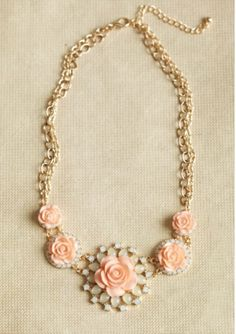Peach and gold floral necklace.  #peachjewelry #weddingideas #bridesmaiddresses http://www.thebridelink.com/blog/2013/04/15/mint-and-peach-wedding-ideas-for-bridesmaids/