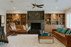 Ranch Inspired Contemporary Living Room With Leather Seating, Mirror Coffee Table and Display Shelves