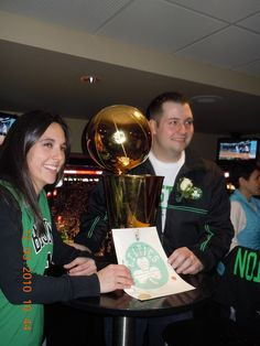 Kelly and James with the Celtics Trophy and Marriage Certificate that I made for the couple.