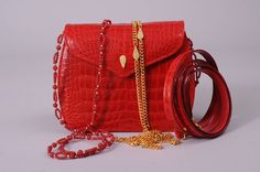 Lana Marks Red Alligator Clutch with Three Straps, Never Used | From a collection of rare vintage evening bags and minaudières at https://www.1stdibs.com/fashion/handbags-purses-bags/evening-bags-minaudieres/