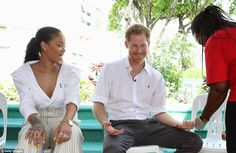 The singer watches as the royal has his blood taken for the HIV test to mark World Aids Day