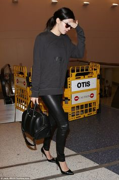 What would Yeezus do? The model was spotted at LAX wearing her brother in law's Yeezy sweatshirt and a pair of tight leather pants, brandishing a Givenchy tote worth around $2,000.