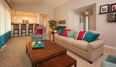 Bright teal and fuchsia accents in living room design by Kathleen Jennison