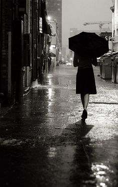 Black and white Photography woman walking down street with umbrella on rainy night alleyway I Love Rain, No Rain, Walking In The Rain, Singing In The Rain, Rainy Night, Rainy Days, Stormy Night, Black White Photos, Black And White Photography