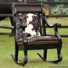 Dark wood, elegant design, chocolate brown leather seat and tri-color cowhide on the back make this rocking chair versatile for traditional or casual homes. Cowhide Decor, Cowhide Furniture, Cowhide Chair, Western Furniture, Rustic Furniture, Cool Furniture, Bedroom Furniture, Furniture Design, Cabin Furniture