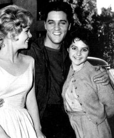 Elvis on the set of his movie Wild in the country ( fall 1960 ) with  actress Tuesday Weld ( left ) and the 16 years old female singer Brenda Lee .