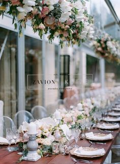 Stunning floral design, white, green, gold, orchids, white orchids, roses, pink, protea, proteas, gold under plates, raw wooden tables, ghost chairs, elegance. Wedding Day, wedding, luxury wedding, bride, bouquets, bouquet,  flower arch, floral arch, best wedding ever, hanging arrangements, suspended arrangement, hanging flowers