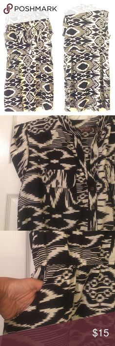 Aztec Black and White Dress This cute black-and-white dress can also double as a tunic and be worn with leggings. Double pockets at breasts and waist. Elastic waistband. 100% polyester. Make an offer! NWOT Speed Control Dresses Midi